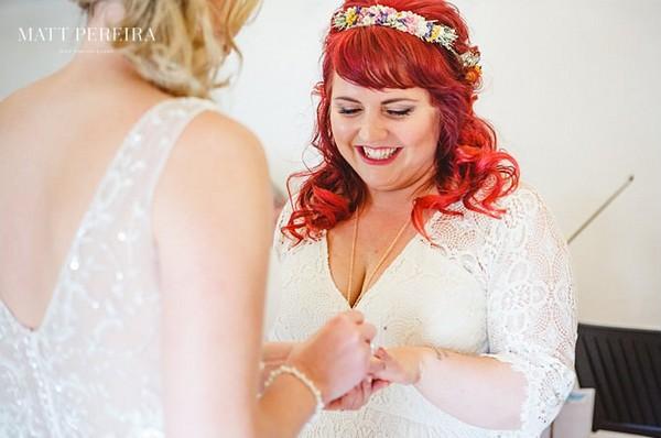 Bride putting ring on bride's finger