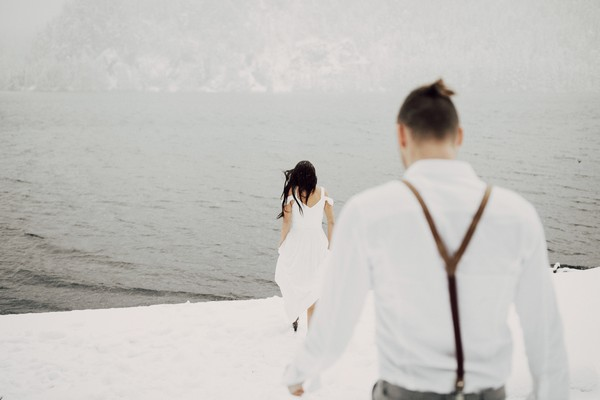 Couple approaching water in the snow