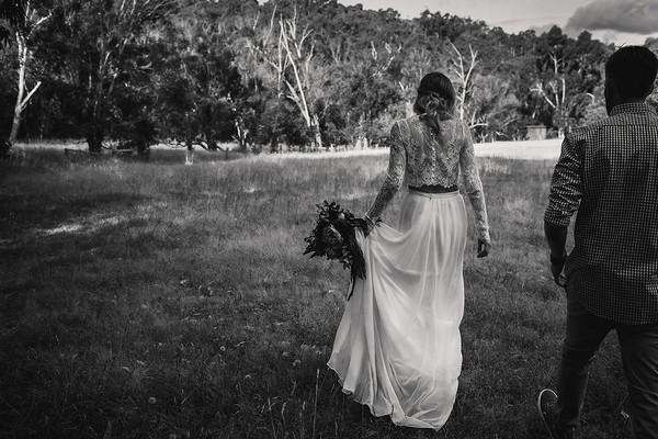 Bride lifting skirt to walk