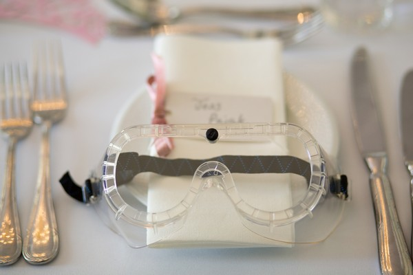 Goggles at wedding place setting