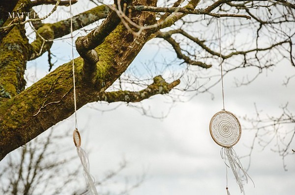 Dream catchers hanging in tree