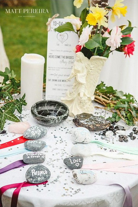 Stones and ribbons on handfasting table