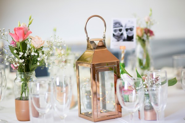 Copper lantern on wedding table