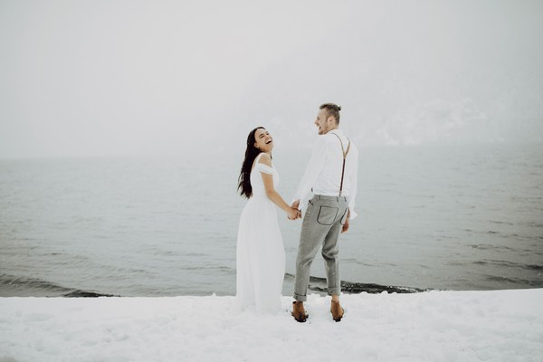 Couple holding hands in the snow