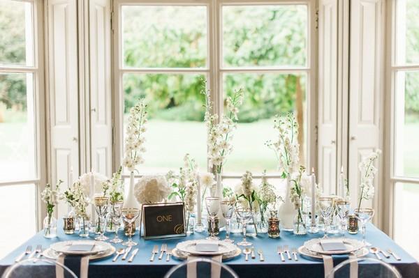 Vases of white flowers on wedding table