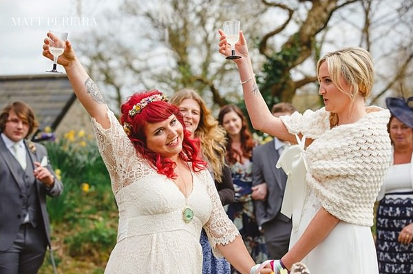 Brides raising glasses
