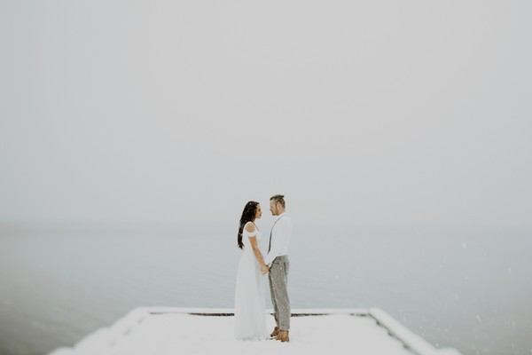 Couple on jetty in snow