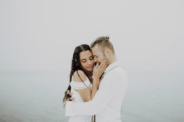 Engaged couple having tender moment