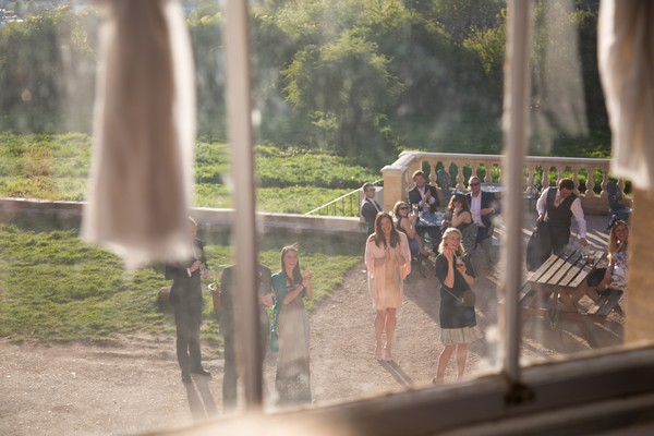 Wedding guests seen through window