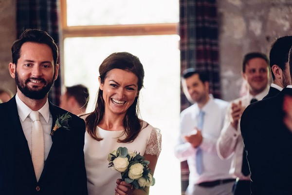 Bride and groom smiling