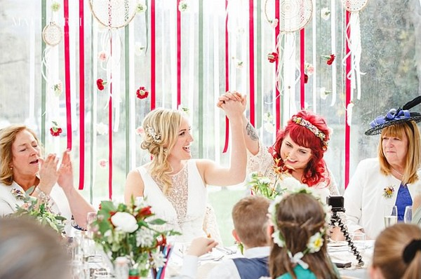 Brides holding hands in the air