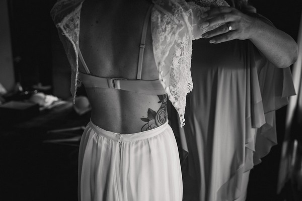 Bride putting on bridal crop top