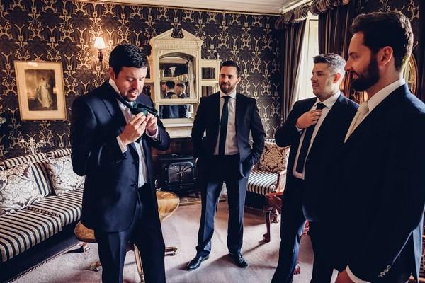 Groomsmen getting ready for wedding
