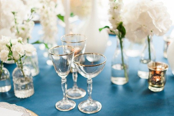 Glasses with gold rims on wedding table