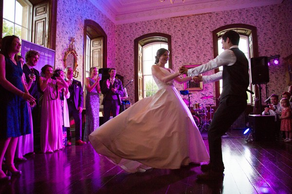 Bride and groom spinning round on dance floor at Kings Weston House