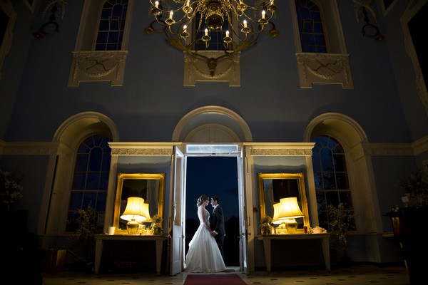 Bride and groom in doorway at Kings Weston House