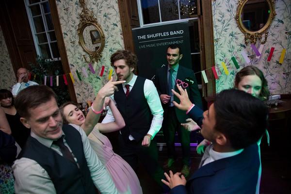 Wedding guests dancing at Kings Weston House