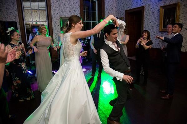 Bride and groom dancing at Kings Weston House