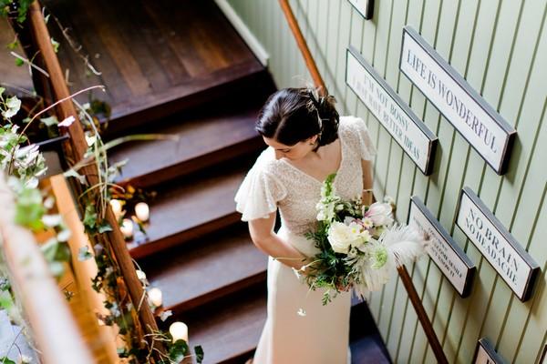 Bride walking down stairs of Park Hotel Hugo de Vries