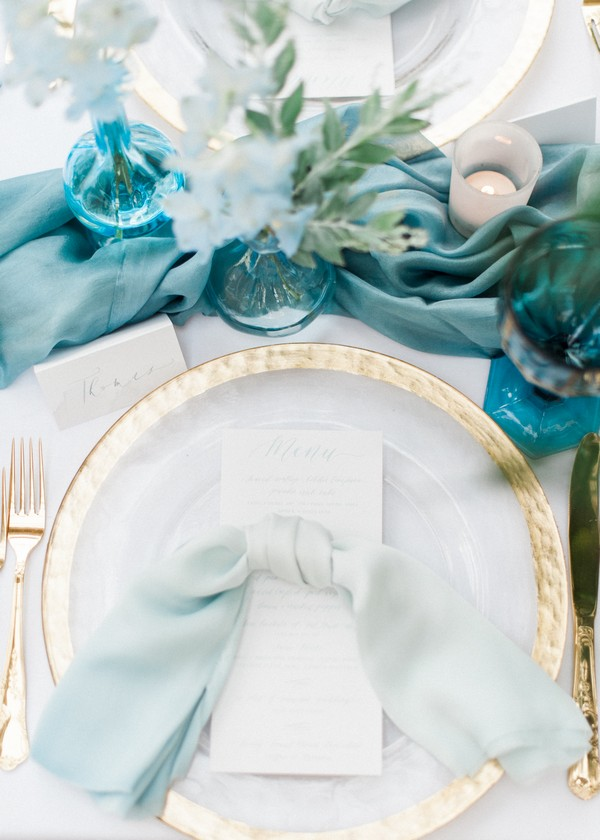 Gold rimmed plate on wedding table