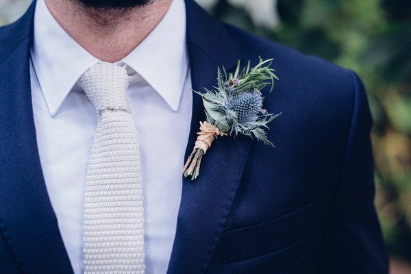 Thistle buttonhole on groom's jacket