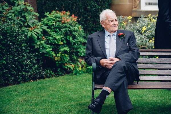 Man sitting on bench before wedding