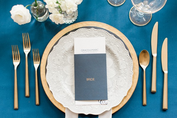 Wedding place setting with navy blue menu