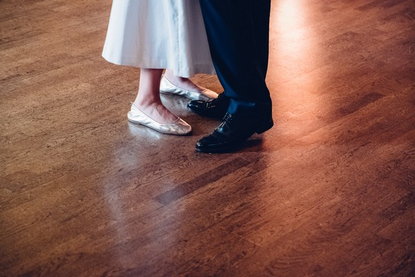 Bride and groom's feet on dance floor