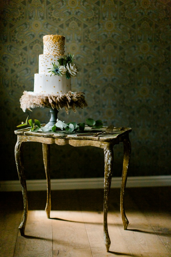 Wedding cake with feathers on table