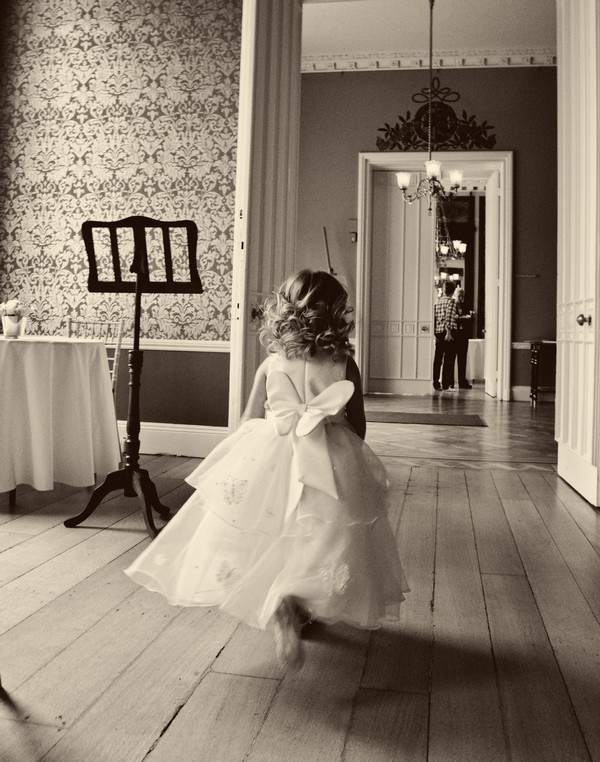 Child Running Through Wedding Venue
