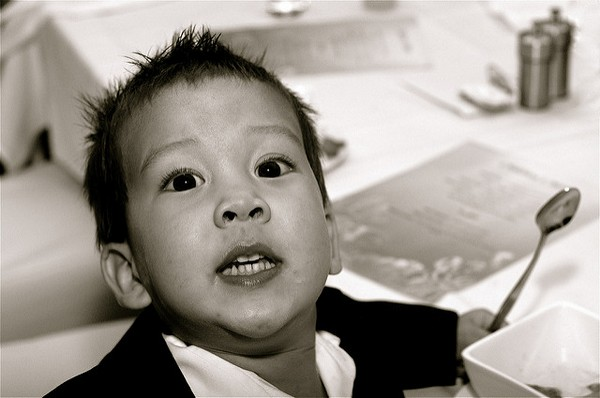 Child Sitting at Wedding Table