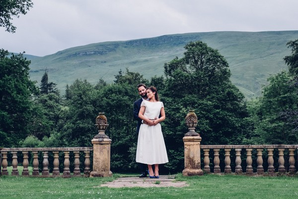 Bride and groom in grounds of Culcreach Castle Hotel