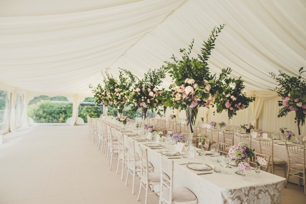 Tall Floral Wedding Table Centrepieces in Marquee