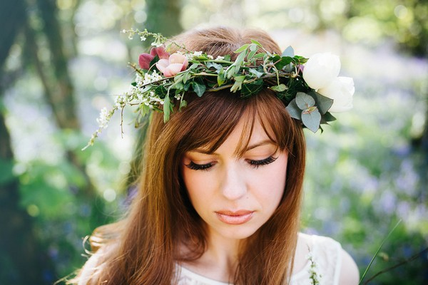 Bride with foliage crown looking down
