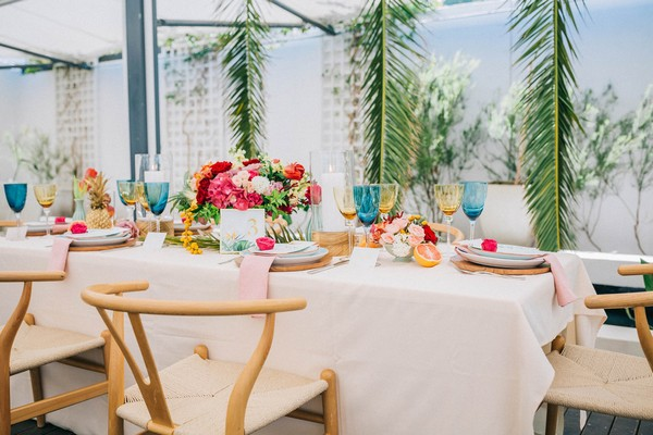 Bright, colourful tropical styled wedding table