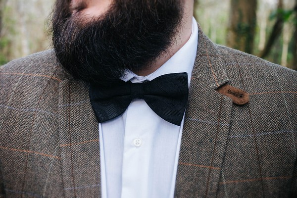 Groom's black bow tie