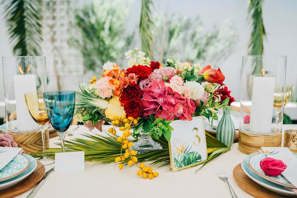 Bright and colourful wedding table flowers
