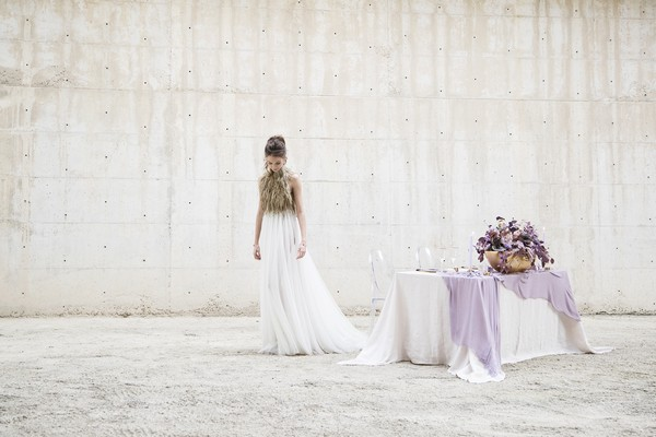 Bride standing by table