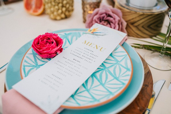 Wedding menu on bright blue plate