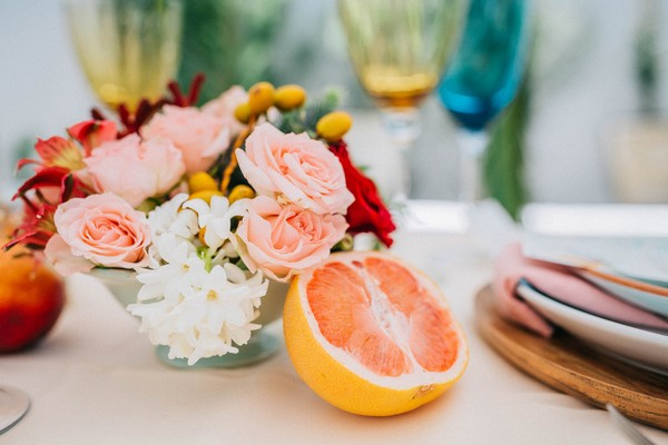 Wedding table flowers and pink grapefruit