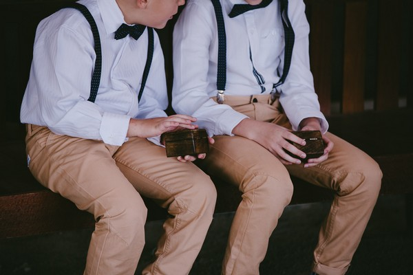 Pageboys holding ring boxes