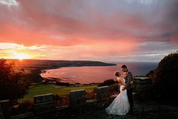 Bride and groom with pink sky of beautiful sunset - Picture by CJRodgers Photography