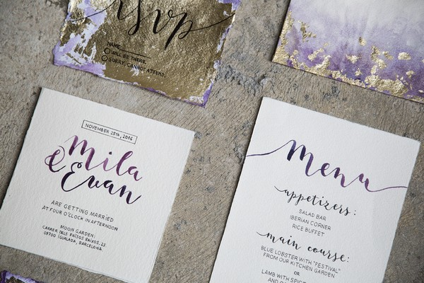 Gold and purple wedding stationery