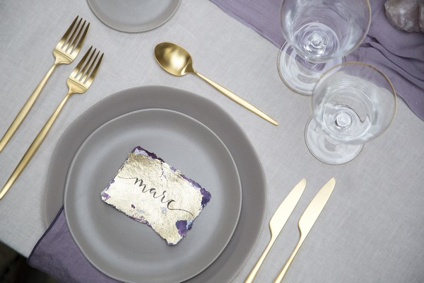 Wedding place setting with gold cutlery