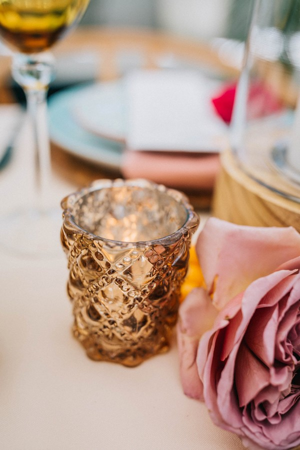 Gold votive on wedding table
