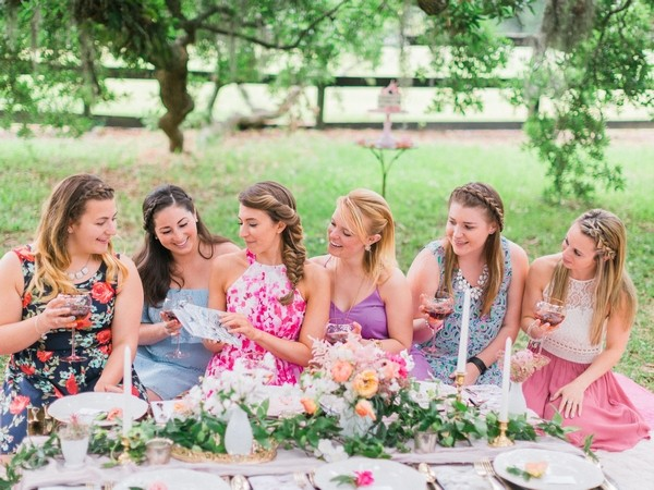 Girls sitting at picnic table for hen party