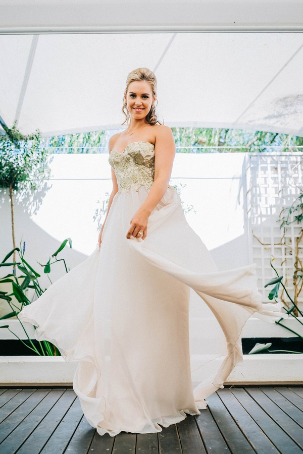 Bride twirling in wedding gown