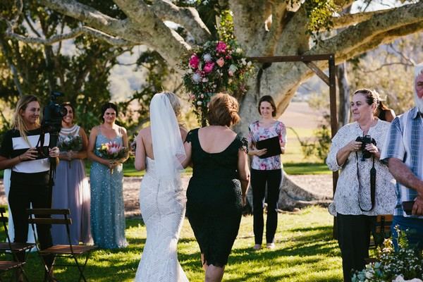 Mother walking bride down the aisle at Yandina Station wedding
