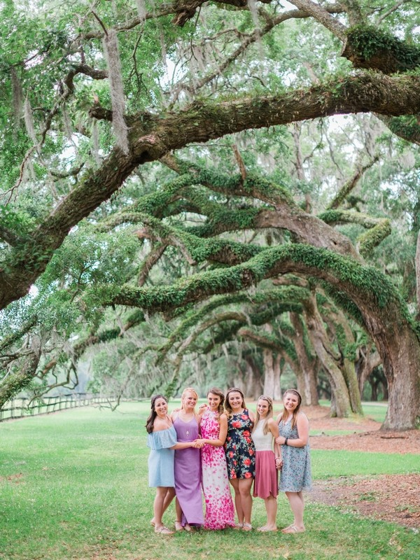 Girls standing under tree