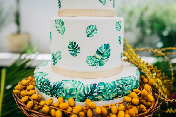 Palm leaves detail on tropical wedding cake